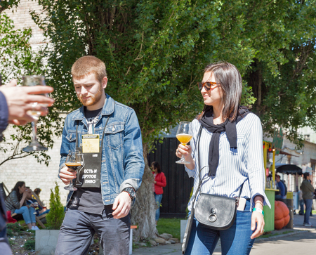 KYIV, UKRAINE - MAY 20, 2018: People visit craft Kyiv Beer Festival vol. 3 in Art Zavod Platforma. About 300 unique varieties of craft beer were presented here.