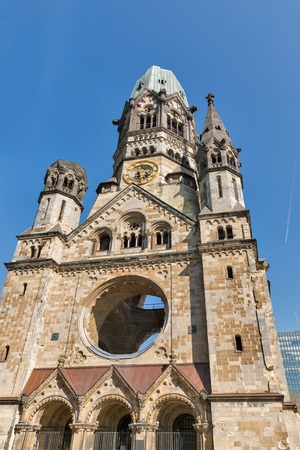 Kaiser Wilhelm Memorial Church in Berlin, Germany. It is one of Berlins most famous landmarks. Damaged church tower is a symbol of Berlins resolve to rebuild city after war.