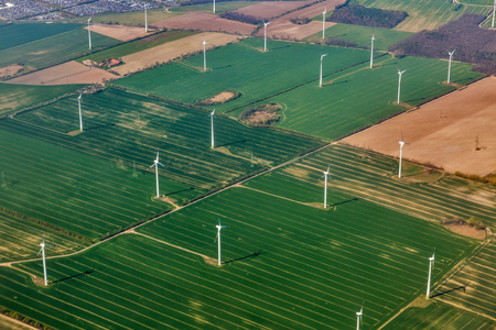 Aerial view over wind mill turbine farm close to Berlin, Germany.