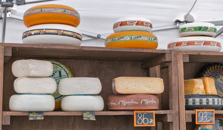KYIV, UKRAINE - APRIL 21, 2019: Dutch and Italian sheep and goat cheeses booth at Food and Wine Festival in National Expocenter, a permanent multi-purpose exhibition complex.