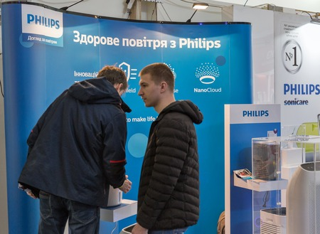 KYIV, UKRAINE - APRIL 06, 2019: People visit Philips air conditioners Dutch technology company booth during CEE 2019, the largest electronics trade show of Ukraine in Tetra Pak EC.