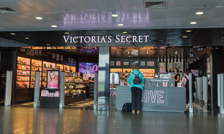 KYIV, UKRAINE - APRIL 18, 2019: People visit Victorias Secret shop at Boryspil International Airport. Its the largest American retailer of lingerie, it was founded by Roy Raymond in 1977.