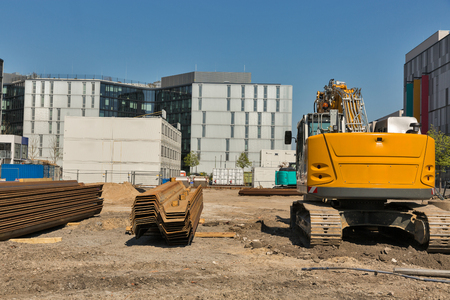 Construction site with digger in Berlin, Germany.