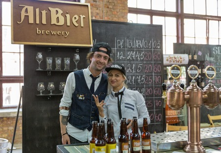 KYIV, UKRAINE - MAY 18, 2019: Bartenders work at Alt Bier brewery booth during Kyiv Beer Festival vol. 4 in Art Zavod Platforma. More than 60 craft beer breweries were presented here.