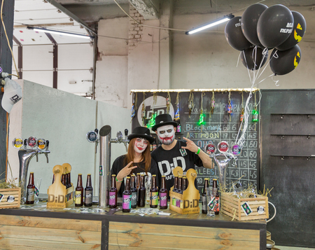KYIV, UKRAINE - MAY 18, 2019: Bartenders work at DiD craft beer brewery booth during Kyiv Beer Festival vol. 4 in Art Zavod Platforma. More than 60 craft beer breweries were presented here.
