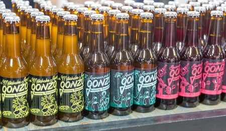 KYIV, UKRAINE - MAY 18, 2019: Gonzo craft beer brewery bottles closeup at booth during Kyiv Beer Festival vol. 4 in Art Zavod Platforma. More than 60 craft beer breweries were presented here. Redakční