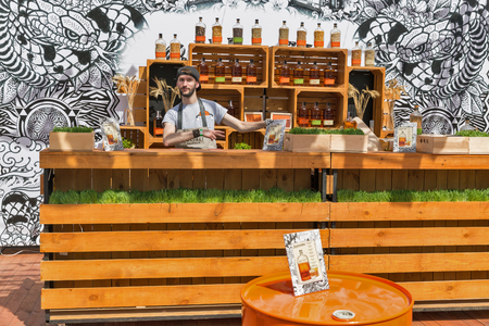 KYIV, UKRAINE - MAY 18, 2019: Bartender works at Bulleit Bourbon frontier whiskey booth during Kyiv Beer Festival vol. 4 in Art Zavod Platforma. It is a brand of Kentucky straight bourbon whiskey. Redakční