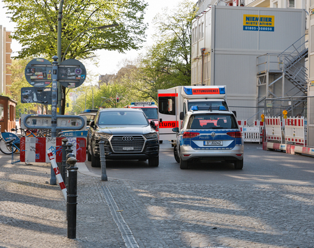 BERLIN, GERMANY - APRIL 18, 2019: Emergency accident with German national police cars and ambulance trucks. Berlin is the capital and largest city of Germany by both area and population.
