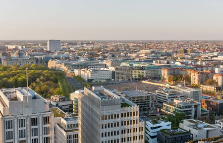 Aerial cityscape with Memorial to the Murdered Jews of Europe, Tiergarten park, Reichstag and Charite hospital at sunset close to Potsdamer Square.