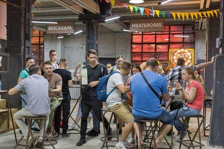 KYIV, UKRAINE - MAY 18, 2019: People visit Kyiv Beer Festival vol. 4 in Art Zavod Platforma. More than 60 craft beer breweries were presented here.