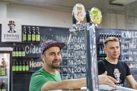 KYIV, UKRAINE - MAY 18, 2019: Friday craft brewery bartenders work at Kyiv Beer Festival vol. 4 in Art Zavod Platforma. More than 60 craft beer breweries were presented here. Redakční