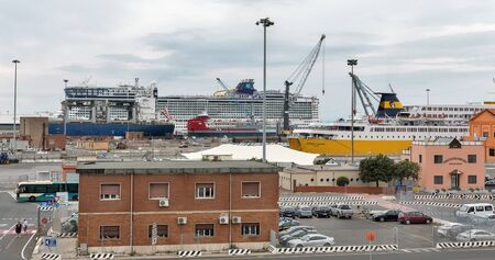 LIVORNO, ITALY - JULY 11, 2019: Ships moored in ferry port terminal. Port of Livorno is one of the largest Italian seaports and one of the largest seaports in the Mediterranean Sea.