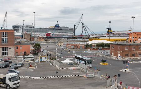LIVORNO, ITALY - JULY 11, 2019: Ships moored in ferry port terminal. Port of Livorno is one of the largest Italian seaports and one of the largest seaports in the Mediterranean Sea. 스톡 콘텐츠 - 133521876