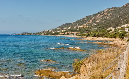 Stunning Corsica coastline with rocky beach and tourquise clear water near Ajaccio, Corsica, France.