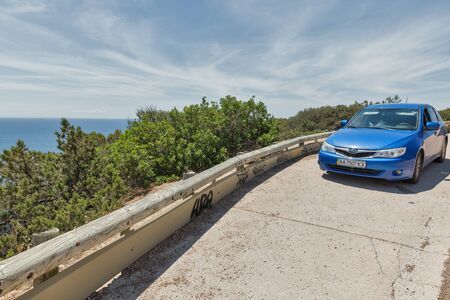 ROCCAPINA, CORSICA, FRANCE - JULY 17, 2019: Subaru Impreza blue car parked roadside on Roccapina coast. Corsica is located southeast of the French mainland and west of the Italian Peninsula. Sajtókép