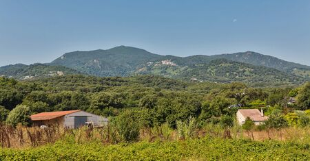 Corsica island landscape with farm and mountains, France.