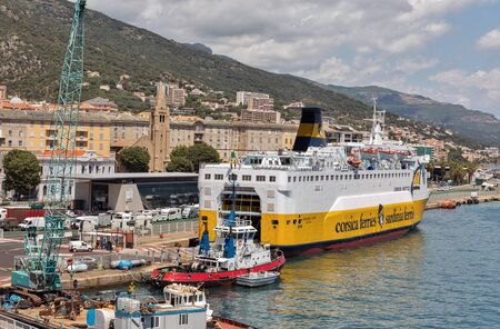 BASTIA, CORSICA, FRANCE - JULY 12, 2019: Corsica Ferries - Sardinia Ferries ship moored in port. It is a ferry company that operates traffic to and from Corsica, Sardinia and Elba. 스톡 콘텐츠 - 133522606