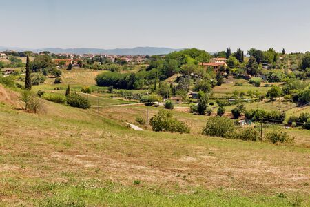 Summer lasndscape with view over San Romano village in Tuscany, Western Italy. Standard-Bild