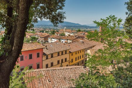 View over Montopoli town with Campanaria medieval tower from castle hill. Montopoli in Val d'Arno is a municipality in the Province of Pisa in the Italian region Tuscany. 스톡 콘텐츠