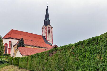 Landscape with Parish Church of St. Peter near Maribor, Slovenia. Standard-Bild