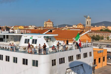 LIVORNO, ITALY - JULY 23, 2019: People travel on deck of Corsica Ferries - Sardinia Ferries ship in port. It is a ferry company that operates traffic to and from Corsica, Sardinia and Elba. 에디토리얼