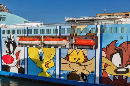 LIVORNO, ITALY - JULY 12, 2019: Moby Wonder ferry ship closeup. Italian company Moby Lines is known for using Warner Bros. Looney Tunes characters as the external livery of its ships.