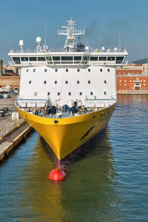 LIVORNO, ITALY - JULY 23, 2019: Mega Express Three ferry ship for Corsica Ferries - Sardinia Ferries moored in port. It is a ferry company that operates traffic to and from Corsica, Sardinia and Elba.