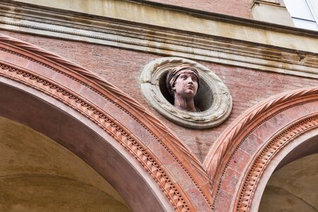 Bolognini Amorini Salina Palace on Santo Stefano street in Bologna historic center, Italy. Palace is notable by its circular niches with busts on the facade.