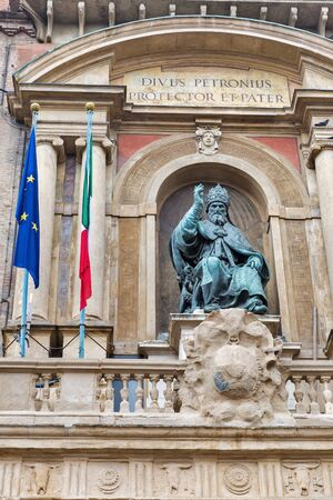 Accursio Palace or City Hall exterior in Bologna, Italy. Bronze statue of Pope Gregory XIII, sitting and blessing.