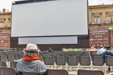 BOLOGNA, ITALY - JULY 10, 2019: People visit Il Cinema Ritrovato Festival outdoor in city historic center. It is a festival dedicated to the history of cinema, classics, retrospectives and screening the latest restored film. Sajtókép