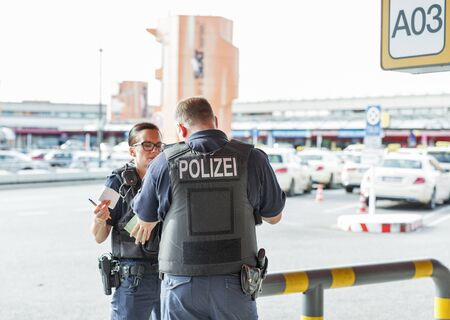 BERLIN, GERMANY - OCTOBER 18, 2019: Police patrol in Tegel airport. Police on high terror alert warned to be hyper vigilant. Berlin is the capital and largest German city by both area and population.