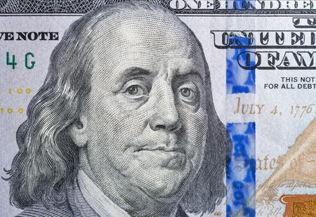 US President Benjamin Franklin macro portrait on one hundred dollar bill fragment