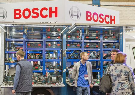 KYIV, UKRAINE - APRIL 13, 2019: People visit Bosch, a German multinational engineering and electronics company booth during CEE 2019, largest electronics trade show of Ukraine in Tetra Pack EC. Éditoriale
