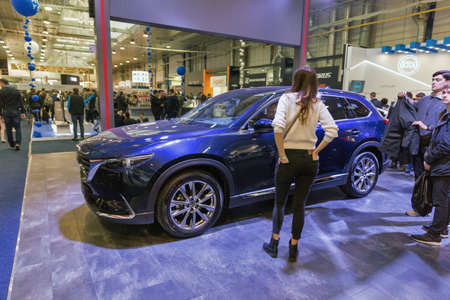 KYIV, UKRAINE - APRIL 13, 2019: People visit Mazda hybrid electric cars booth during CEE 2019, the largest electronics trade show of Ukraine in Tetra Pack EC.