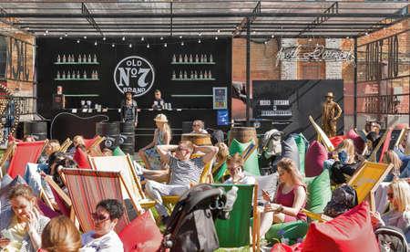 KYIV, UKRAINE - MAY 20, 2018: People enjoy music, food and craft beer during Kyiv Beer Festival vol. 3 in Art Zavod Platforma. About 300 unique varieties of craft beer were presented here. Redakční