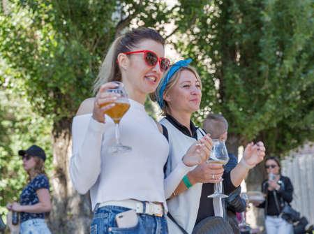 KYIV, UKRAINE - MAY 20, 2018: Young people visit craft Kyiv Beer Festival vol. 3 in Art Zavod Platforma. About 300 unique varieties of craft beer were presented here.