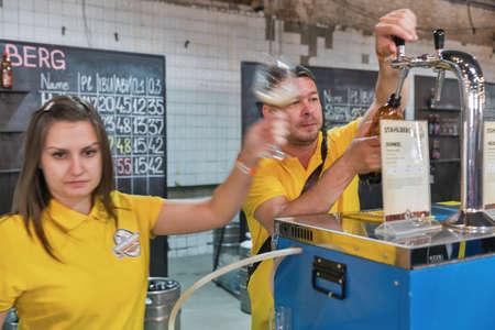 KYIV, UKRAINE - MAY 20, 2018: Bartenders pour Stahlberg Brewery craft beer at Kyiv Beer Festival vol. 3 in Art Zavod Platforma. About 300 unique varieties of craft beer were presented here.