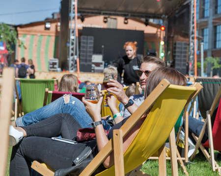 KYIV, UKRAINE - MAY 20, 2018: People enjoy music, food and craft beer during Kyiv Beer Festival vol. 3 in Art Zavod Platforma. About 300 unique varieties of craft beer were presented here.