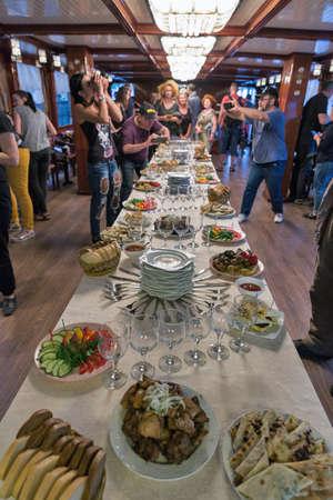 ZAPORIZHZHYA, UKRAINE - JUNE 28, 2018: Evening party on Borisfen pleasure boat during PhotoCamp Ukrainian photographers annual meeting.