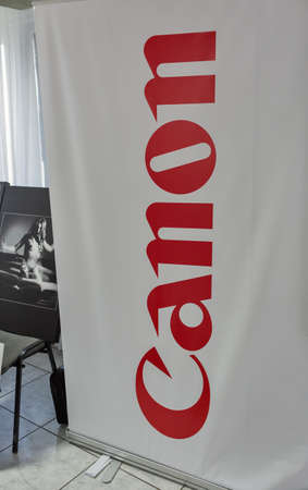 ZAPORIZHZHYA, UKRAINE - JULY 03, 2018: Canon banner at Ukrainian photographers annual meeting PhotoCamp on Khortytsia island. Canon is Japanese corporation specializing in imaging and optical products