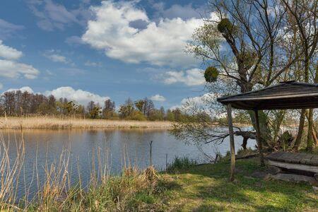 Quiet Ros riverbank in early spring wiyh wooden gazebo, Ukraine Zdjęcie Seryjne