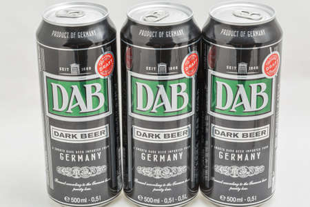 KYIV, UKRAINE - DECEMBER 31, 2019: DAB dark German beer cans closeup against white background. Dortmunder Actien Brauerei is a German brewery in the city of Dortmund, founded in 1868. Éditoriale
