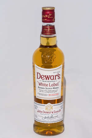 KIEV, UKRAINE - NOVEMBER 11, 2018: Dewar's White Label blended Scotch Whisky bottle closeup against whie background. Dewar's whiskies have won more than 400 awards and medals in over 20 countries.