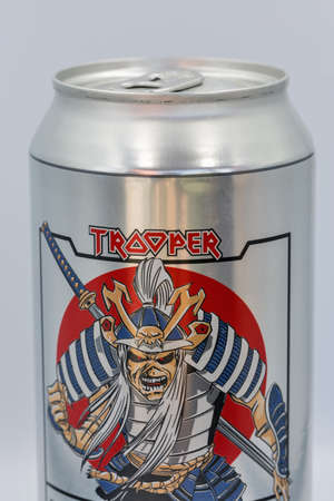 KYIV, UKRAINE - JUNE 06, 2020: Can of Trooper Sun and Steel lager beer infused with authentic Japanese sake created by British heavy metal rock band Iron Maiden closeup against white background. Editöryel