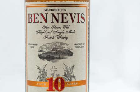 KYIV, UKRAINE - SEPTEMBER 21, 2019: Ben Nevis ten years old Highland Single Malt Scotch Whisky bottle label closeup against white background. Ben Nevis is the highest mountain in the British Isles.