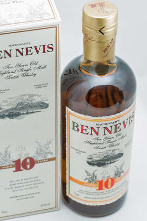 KYIV, UKRAINE - SEPTEMBER 21, 2019: Ben Nevis ten years old Highland Single Malt Scotch Whisky bottle and box closeup against white background. Ben Nevis is the highest mountain in the British Isles. Éditoriale