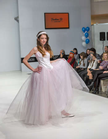 KYIV, UKRAINE - FEBRUARY 09, 2018: Fashion young girl teenager beautiful model at Kyiv Fashion 2018 in KyivExpoPlaza exhibition center. It is the main b2b event of Ukrainian fashion industry.