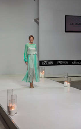KYIV, UKRAINE - FEBRUARY 07, 2018: Fashion young beautiful model at Kyiv Fashion 2018 in KyivExpoPlaza exhibition center. It is the main b2b event of Ukrainian fashion industry.