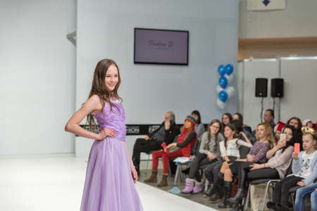 KYIV, UKRAINE - FEBRUARY 09, 2018: Fashion young girl teenager beautiful model at Kyiv Fashion 2018 in KyivExpoPlaza exhibition center. It is the main b2b event of Ukrainian fashion industry.