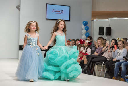 KYIV, UKRAINE - FEBRUARY 09, 2018: Fashion young little girls beautiful models at Kyiv Fashion 2018 in KyivExpoPlaza exhibition center. It is the main b2b event of Ukrainian fashion industry.